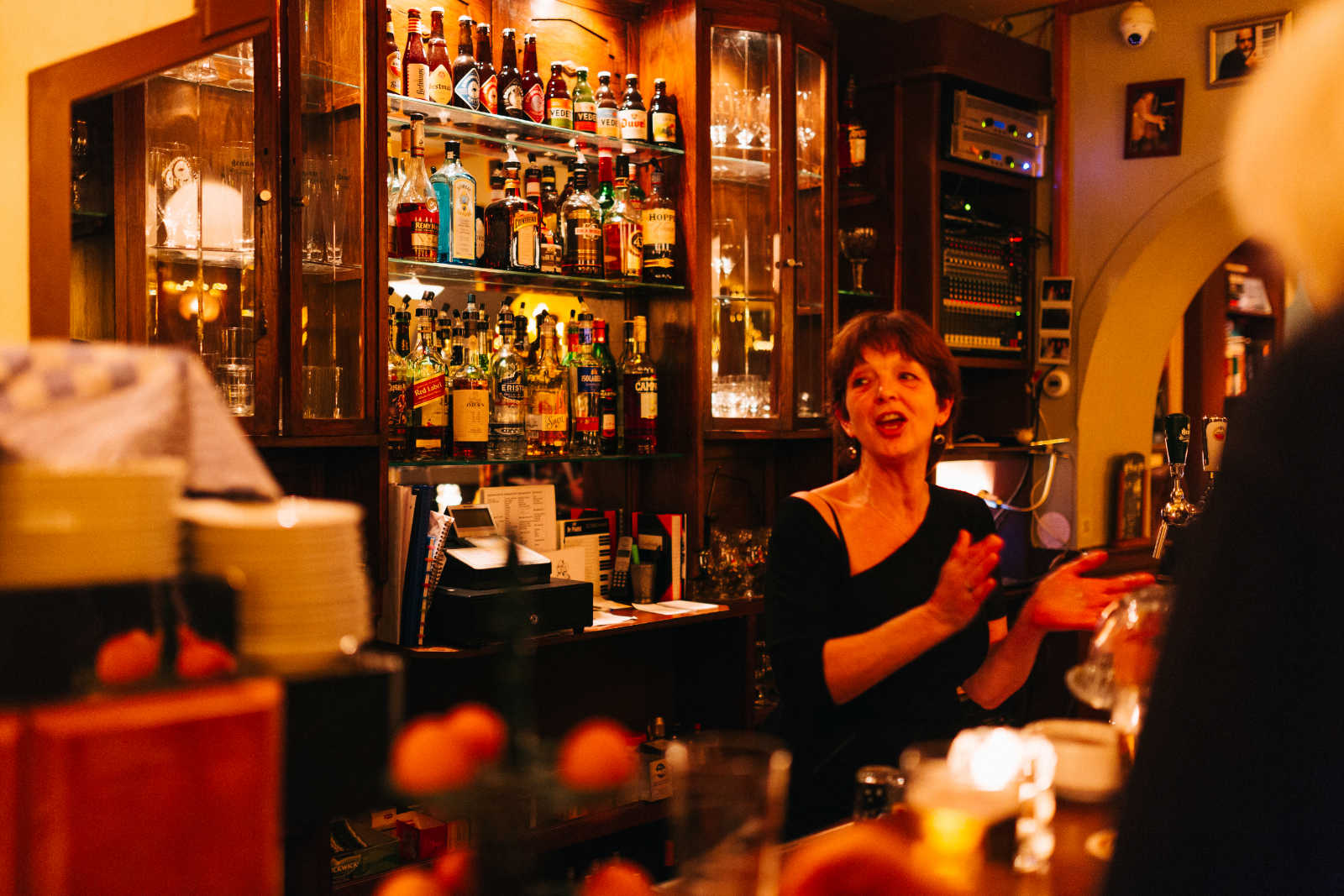 a woman behind the bar